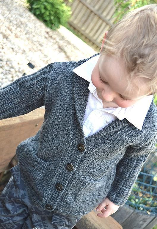 Free knitting pattern for child's Cardigan with Shawl collar and pockets. Sizes -- 2 -3 years, 3-4 years, 5-6 years, 7-8 years, 9-10 years