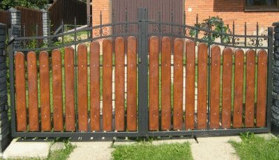 metal driveway gate with wood panels