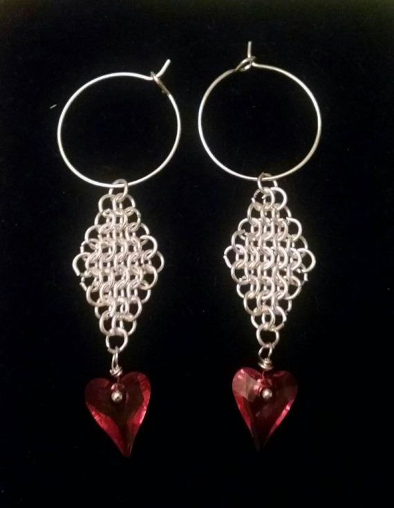Hoop and dangle red heart earrings.
