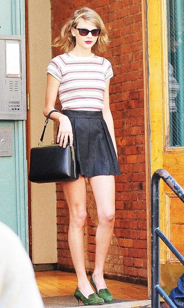 Taylor Swift elevates a plain striped tee with a cute skater skirt and green suede heels