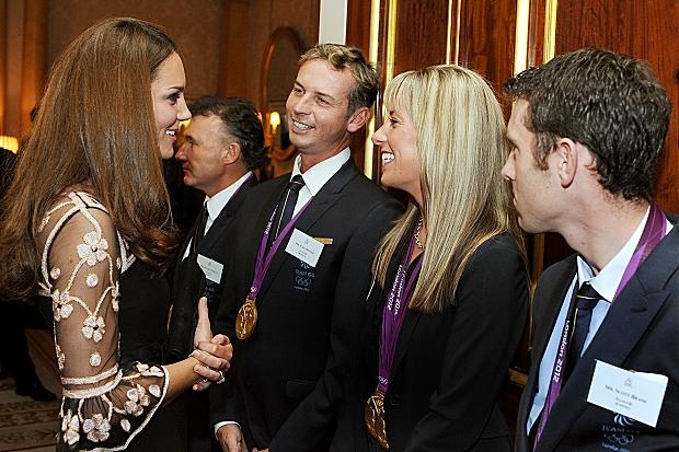Catherine, Duchess of Cambridge (L) smiles as she talks to (L-R) Carl Hester, Charlotte Dujardin and Scott Brash during a reception held for Team GB Olympic and Paralympic London 2012 medalists at Buckingham Palace on October 23, 2012 in London, England.
