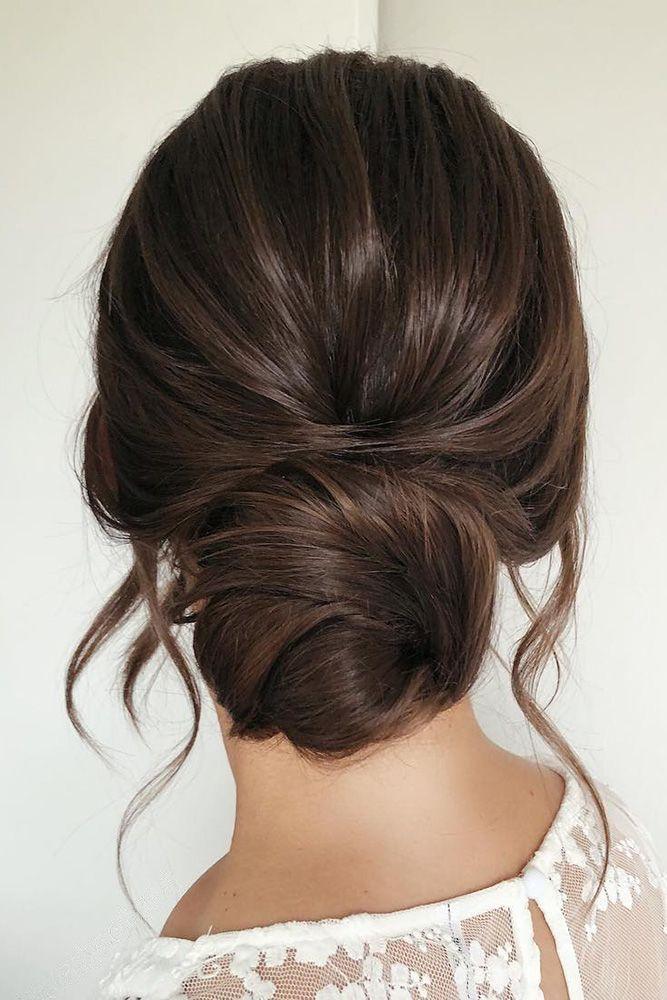 Hochzeitsfrisuren für langes Haar niedrig einfache Brötchen auf dunklem Haar m…