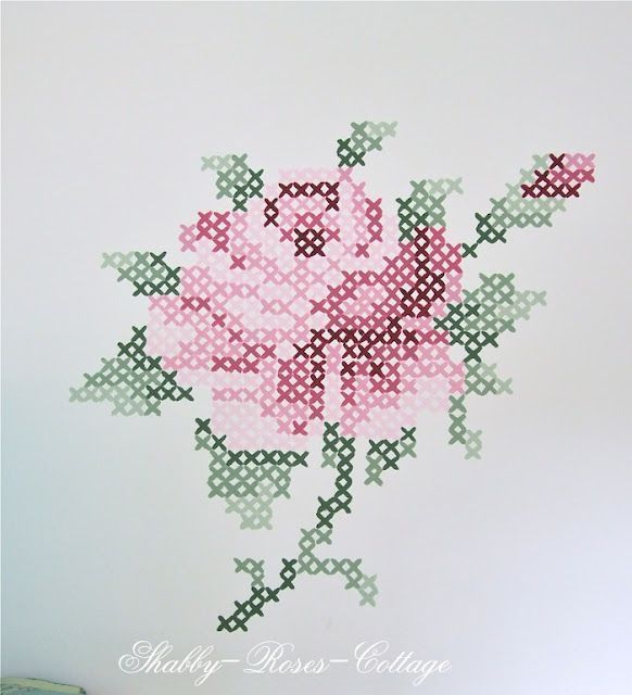 cross stitch pattern painted on a wall