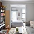 One New Yorker has managed to squeeze in a full-sized bed, an 88-key keyboard, and a table that can seat up to six people, all while maintaining the spacious, relaxing feel you would expect from a much larger apartment. Here's how she does it.