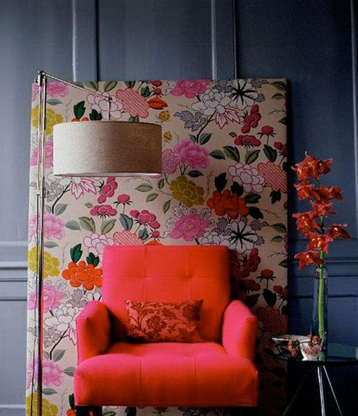 Cover a large piece of second hand art with fabric to create inexpensive art and bring color to a room.