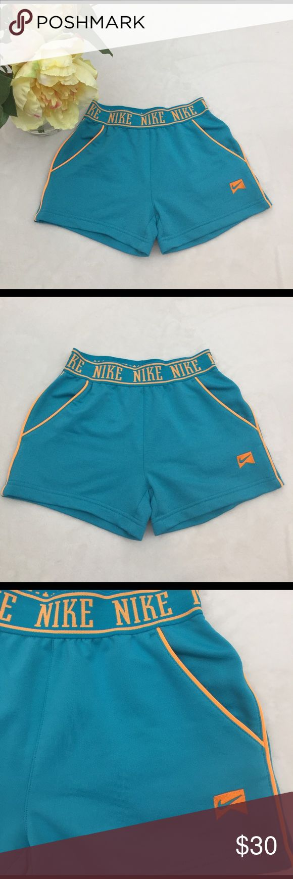 NIKE woman sport shorts blue orange Like new, wore once. Very comfortable for sport and running. Nike Shorts Skorts