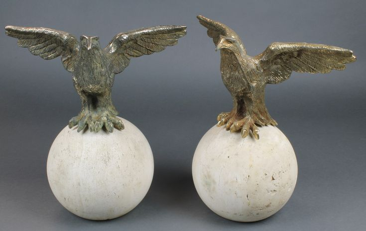 "Lot 243, A pair of gilt metal figures of eagles with outstretched wings, raised on circular turned stone bases 13"", sold for £190"