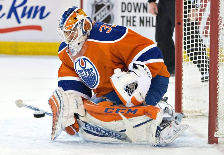 Edmonton Oilers goalie Cam Talbot makes a save against the Calgary Flames during the second period of an NHL hockey game in Edmonton, Alberta, Saturday, Jan. 16, 2016. (Jason Franson/The Canadian Press via AP)