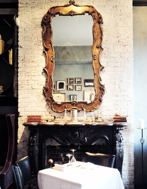 Fireplace seating at Bobo Restaurant NYC.