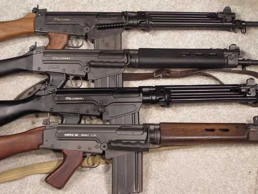 FN Fal Rifle...a nice, hard-hitting weapon in 7.62 NATO. I'm told that the best ones have receivers made by IMBEL, although any of the examples I've seen were more than adequate, regardless of manufacturer. Easily recognized by the swing-up carrying handle found on most versions.