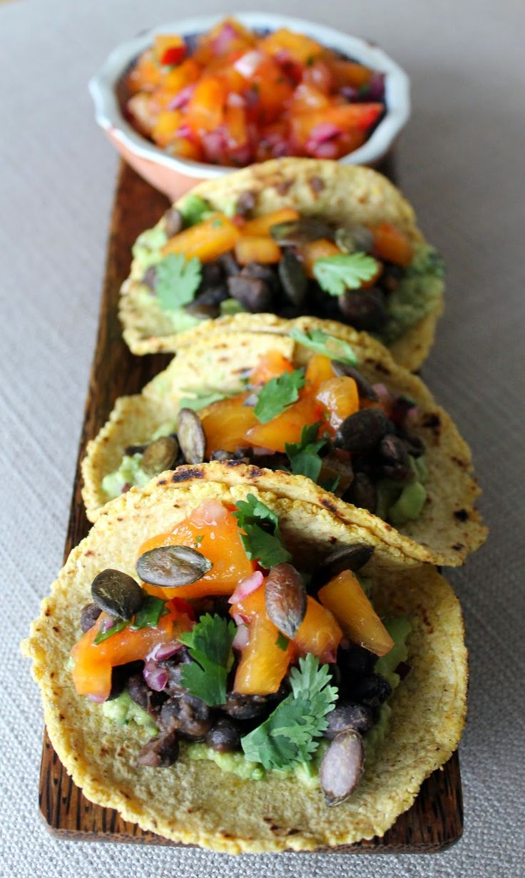 smoky guacamole tacos with stewed black beans and persimmon #vegan