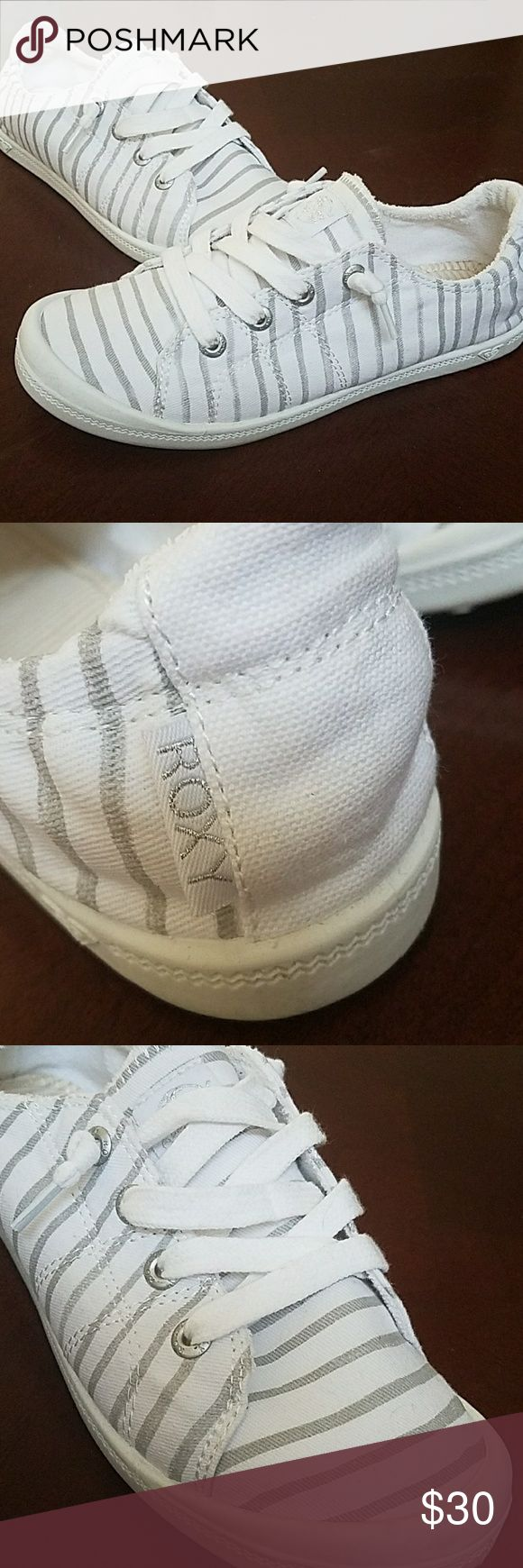 Slip on tennis shoes White with gray stripes soft Roxy tennis shoes. Soft terry cloth inside make these super comfy! Only worn once since they are just a little too small for me. Roxy Shoes Sneakers