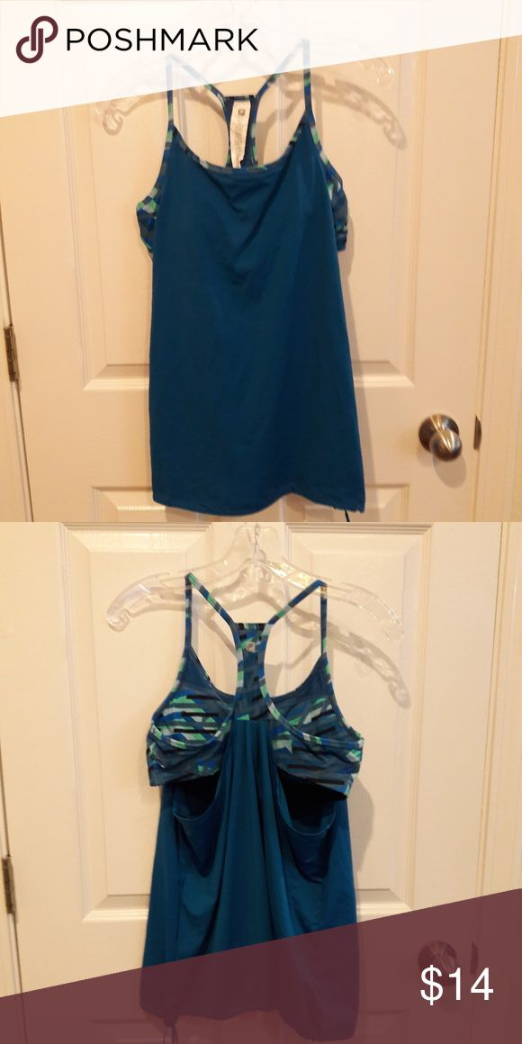 Fabletics sports bra tank Fabletics sports tank bra  open under the sports bra for extra cooling.  The tank is a solid ocean blue with a graphic bra in gray, sea foam green, gray and black accents.  In like new condition. Fabletics Tops Tank Tops