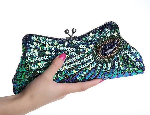 Our 1930's inspired Deco Peacock Evening Purse is a perfect addition to any evening look!   Handbeaded with a reproduction antique metallic frame and chai...
