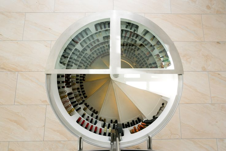 Round glass trapdoor on top of a White Spiral Cellar.