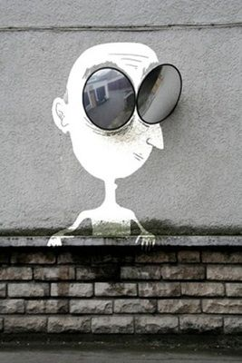 Man on Wall. @designerwallace