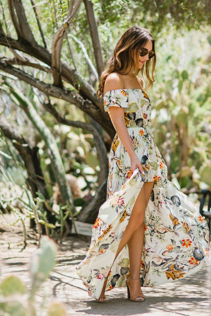 We love this tropical floral maxi dress with built-in shorts making it the best of a jumpsuit and high-low dress...