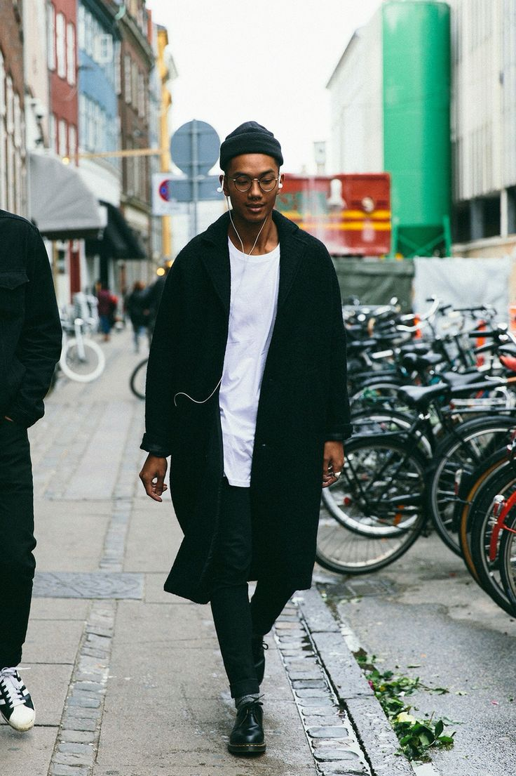 He's got the earphones out to hear everyone commenting on this classic monochrome look. Great attitude, leather shoes, long black coat, and baggy white t-shirt