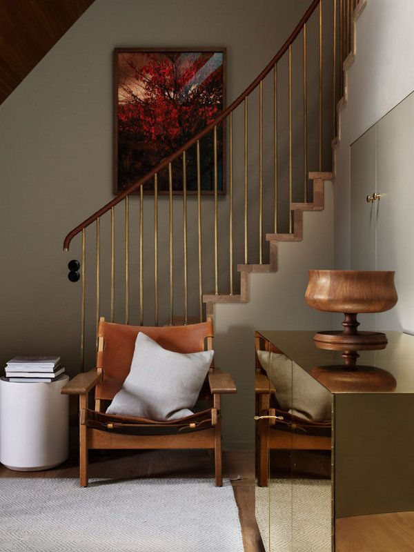 Hand rails, shiny brass block. Turned timber with Borge Morgensen chair. Neutral rug. Cx Ilse Crawford, Stockholm Sweden