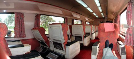 Forget cramped planes or buses. Take the train, put your feet up, enjoy the ride. These are 1st class seats on a Kuala Lumpur to Singapore train, 68 Ringgit (£12 or $21) one way. A bit worn, but comfortable & far more of an experience than flying.