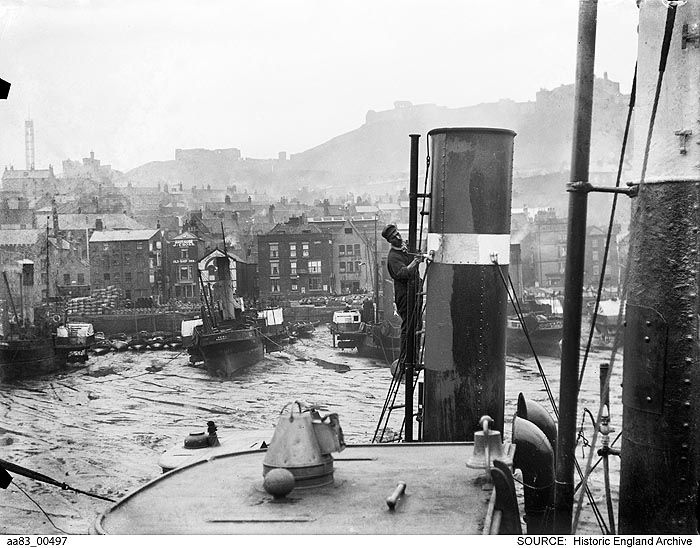 AA83/00497 A view of Scarborough Harbour, with a man painting the funnel of a ship in the foreground. Old Harbour, Scarborough, North Yorkshire   Date 1850 - 1900