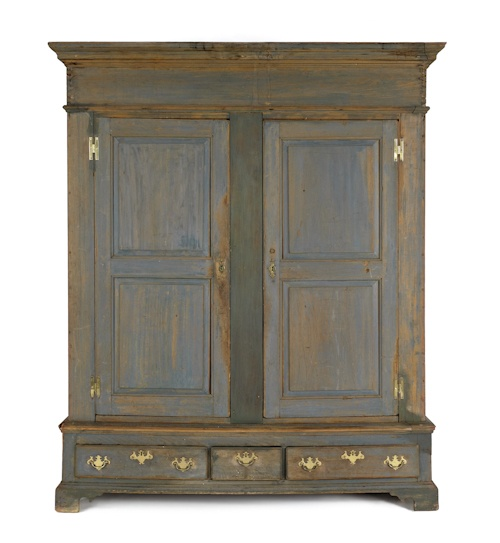 Lancaster County, Pennsylvania painted poplar schrank, circa 1760, retaining its original blue painted surface, 82.5 inches high.