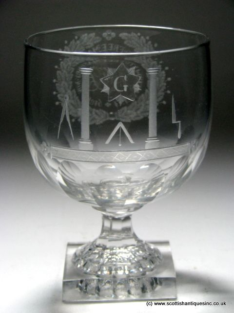 Rare Georgian Masonic Initiation Engraved Rummer c1819 Large cup bowl with slice cutting to the base. Sits on a slice cut stem above a square lemon squeezer foot. Engraved with the tools of the mason including set square, compass, trowel and pillars of temple and more. A beautiful foliate cartouche contains the words 'INITIATED INTO FREE MASONRY NOV 1st 1819' and the initials HJB'. Square base, lemon squeezer foot…