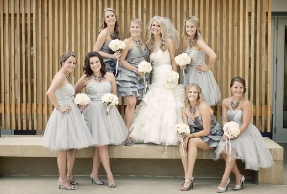 Love the soft grey color and the different style of bridesmaids dresses. Perfect for a summer time wedding