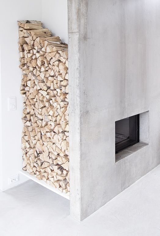 Concrete hearth with built-in wood storage niche
