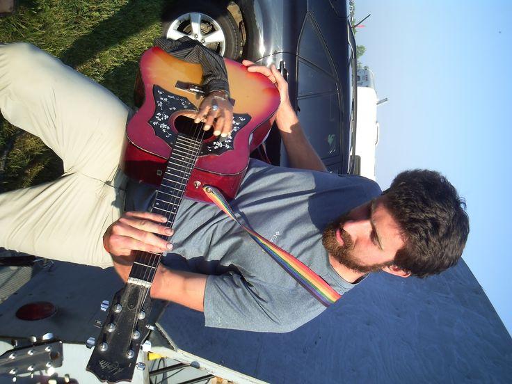 Folk Fest fan strums the guitar