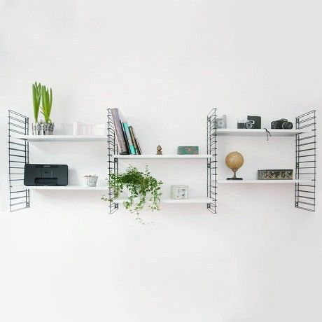 Reintroduced 1950's Dutch design by Adriaan Dekker for Tomado, infinitely expandable wall hung shelves. Steel and plastic coated steel rung sides.