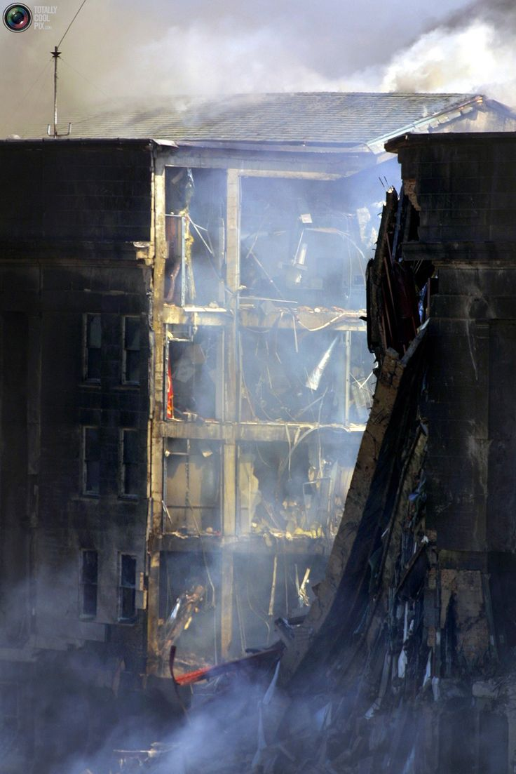 One side of the Pentagon building is exposed after a hijacked airliner crashed into the building in this September 11, 2001 file photo.