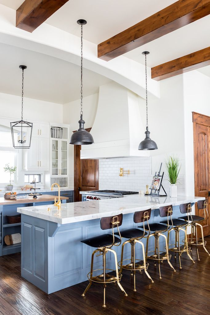 Kitchen features exposed joists and dark wood and brass industrial counter stools to contrast with the soft blue and white colors of the rest of the room in this home in Heber, Utah. [682 × 1023] : RoomPorn #decoratingkitchencounters