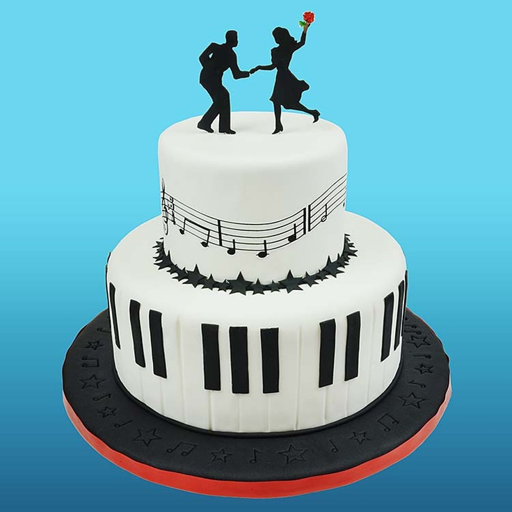 Musical Cake from Global Sugar Art like the bottom how the fondant covers the plate and like he silhouettes dancing : )