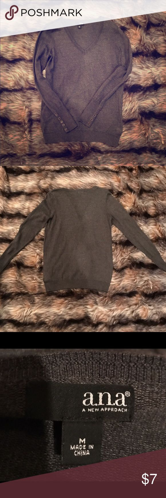 Grey ANA Sweater Grey gently used sweater.  Cuffs have cute button detail. Size medium. ANA Sweaters V-Necks
