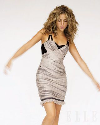 Shakira in 2006 Elle shoot- Black dress with gray chiffon overlay, Ennio Capasa for Costume National