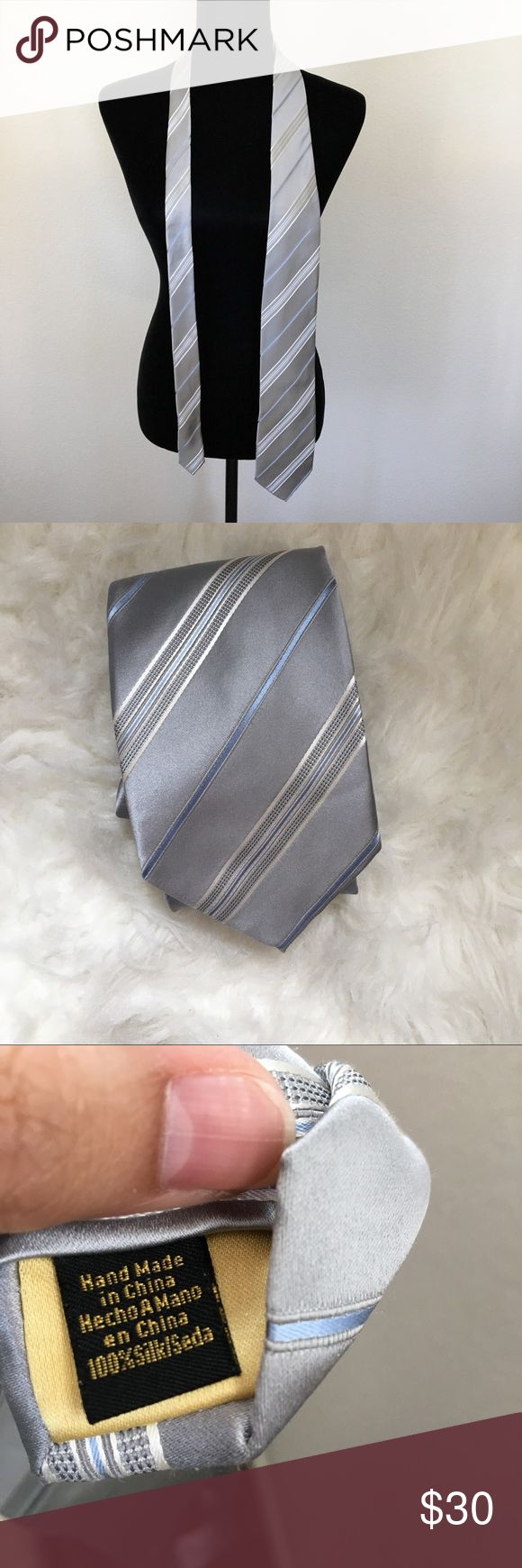 Donald J. Trump Signature Collection Tie Donald J. Trump Tie • Handmade in China • 100% Silk • Colors are Light Blue, Light Gray and White • has Gold little Stamped Plate on back • in Excellent Condition Donald J Trump Accessories Ties