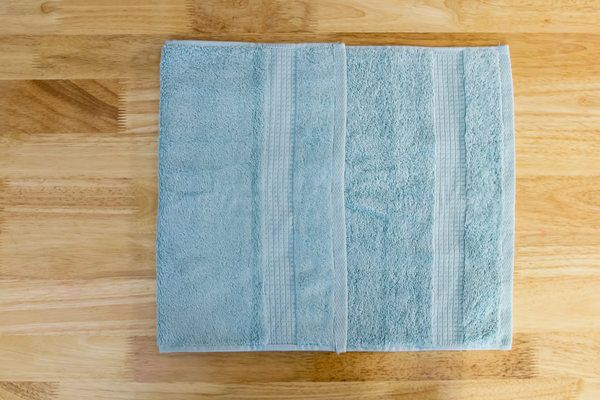How to Hang Bathroom Towels Decoratively (with Pictures) | eHow