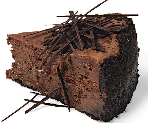 Extreme Chocolate Cheesecake--You can't get more chocolate than this cheesecake: a chocolate-wafer crust, melted dark chocolate in the filling, and chocolate shards scattered over the top.