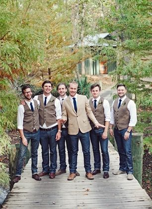 Having a casual, outdoor wedding? Let the groomsmen wear jeans with dress shirts and vests.