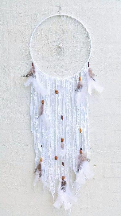 Boho Dreamcatcher - white lace - bohemian wall decor - boho wall hanging - crochet - feather dreamcatcher - silver weaving by Kishayasdreamcatcher on Etsy https://www.etsy.com/nz/listing/512340567/boho-dreamcatcher-white-lace-bohemian