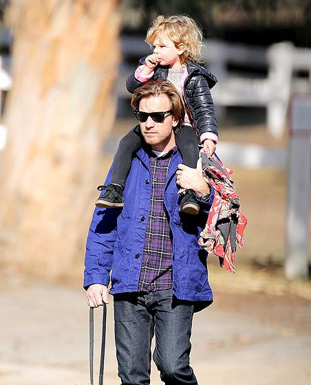 Hands-on daddy Ewan McGregor, in classic wayfarer sunnies, gave his oh-so-cute daughter a piggy back ride on a sunny December afternoon!