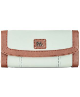 The Sak Iris Leather Wallet $21.93 Stay organized and stylish with this slim leather wallet from The Sak. Boasting a unique, free-spirited design, its pocket-lined interior keeps your currency easily within reach.