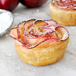 You don't need to be a pastry chef to bake this deliciously tempting rose-shaped dessert. It tastes just like apple pie.  And it looks a lot like a beautiful red rose.  Made with naturally sweet apple slices, sprinkled with cinnamon and rolled up in a perfectly crispy puff pastry. – Manuela from Cooking With Manuela.​ …