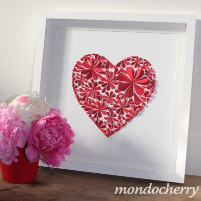 Valentine's Day Frame by Mondocherry.  Add beautiful decor to your home with this stunning frame!  All that is needed is red cardstock, a flower paper punch (try Fiskars Oopsies Daisy) and adhesive!  For a great smooth red cardstock, try Bazzill Basic's Cherry Splash, sold at www.cardstockshop.com.