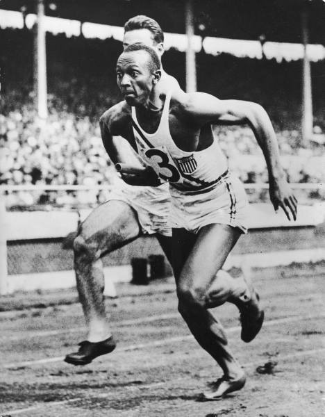 Jesse Owens, USA takes the baton for the last leg of the 4 x 100 meter Olympic final in which the USA won the gold medal in world record time. Berlin, 1936