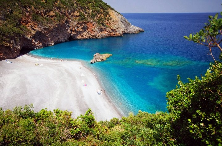 Evia island,Petaloi beachThe largest greek island connected to mainland with a bridge-hot spot for bungee jumpers.The nature and the beauty is so diverse that it is difficult to tell whether you are on an exotic island,a mediterrranean village or a mountain.You can reach it by road or by ferries.Surfing,snorkelling,diving,hiking in canyons,amidst picturesque villages, isolated beaches,busy night life, extraordinary gastronomy,proximity to Athens,Pilion mountain,Sporades isles.And low budget…