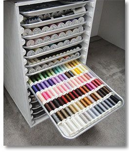 Do-it-yourself thread cabinet. This is a great idea for those of us with tons of thread:); Directions are in Studio magazine, but its $14. I think I could do this to fit my space.