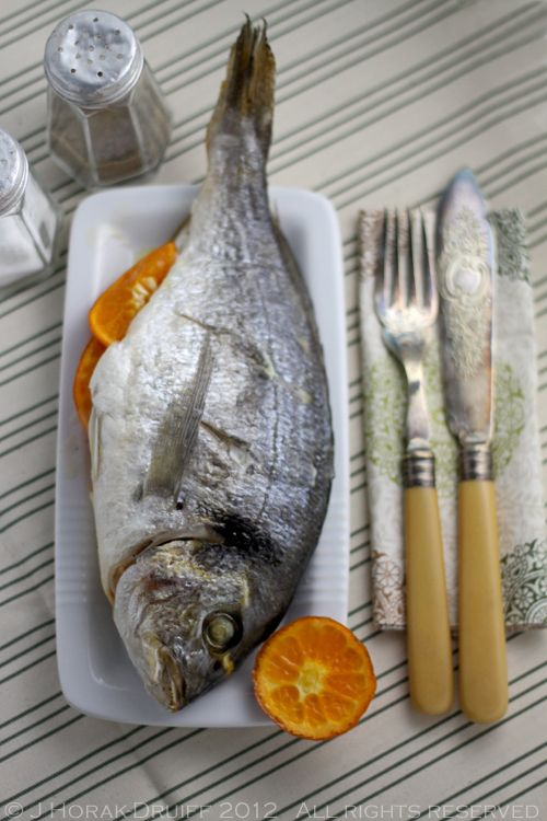 Whole baked gilt-head bream with ClemenGold clementines and thyme butter