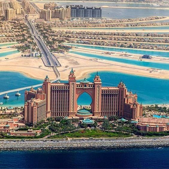 The Palm Hotel at Atlantis in Jumeirah, Dubai. Incredible looking. Even the surround area is amazing. Take the bridge to enter, the perfect sand, the crystal blue water, & the long street on the other side next to the water with automobiles traveling.
